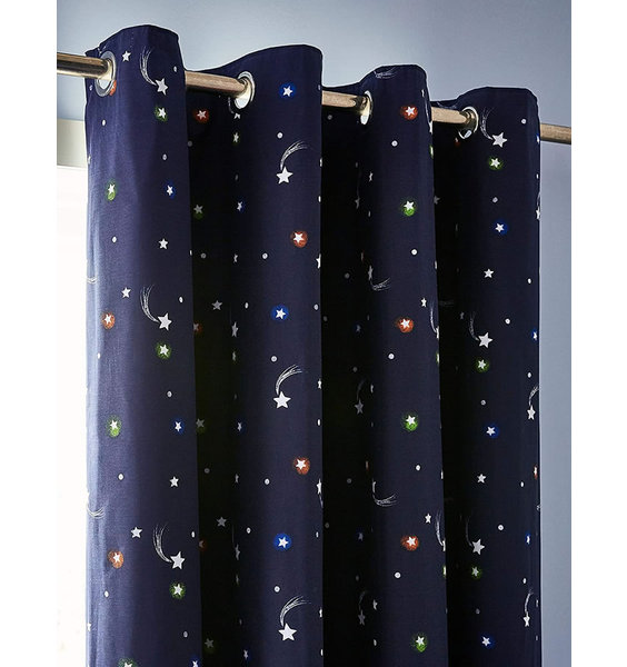 Pair of dark blue, eyelet curtains, patterned with stars and shooting stars