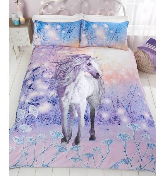 Stunning white unicorn on a wintery background with glitter effect.