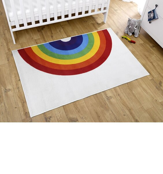 White rug with a large rainbow pattern