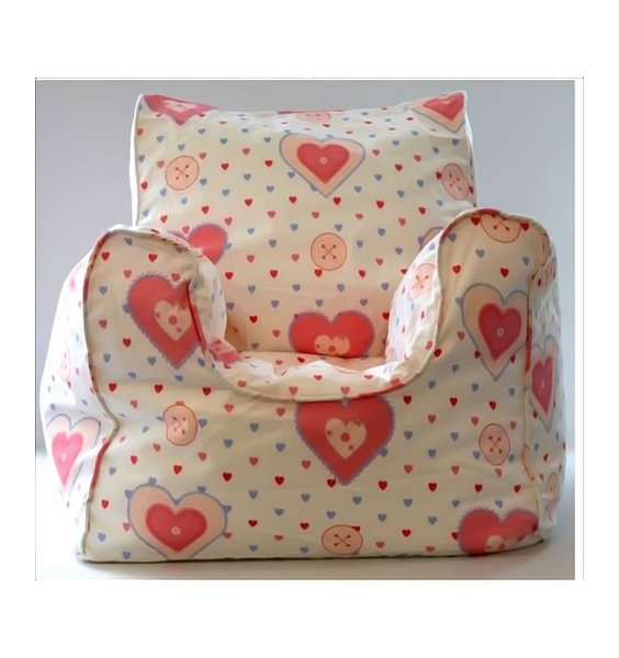 Small, White Bean Filled Armchair For A Little Girl. Pink Piping to the Seams and Patterned With Pink and Blue Lovehearts.