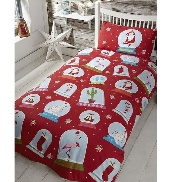 Red Christmas Bedding, patterned with snowflakes and christmassy snow globes.
