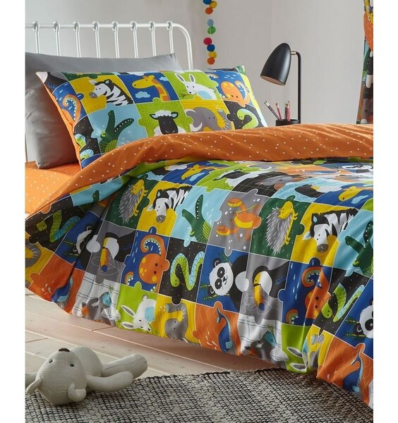 Toddlers reversible duvet cover. Colourful, cute animal filled squares, with a spotted burnt orange reverse.