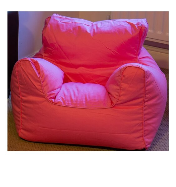 Pink, bean filled, children's armchair with piped edging.