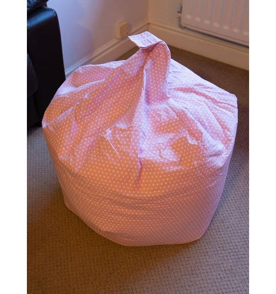 Pink bean bag with a white polka dot pattern