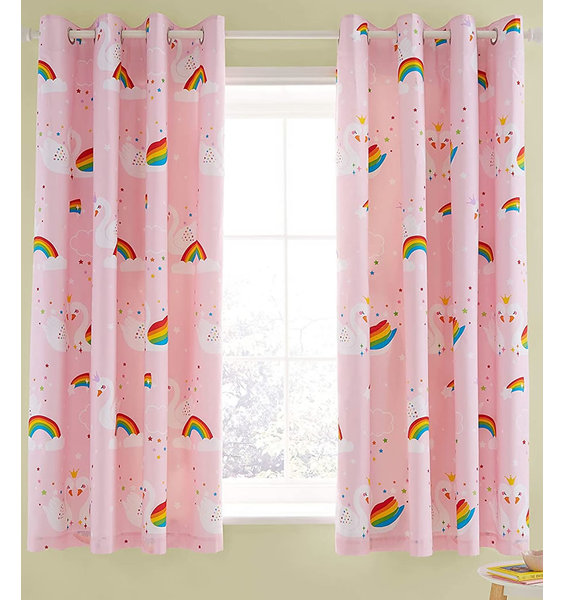Pale pink and white speckled curtains with a white unicorn pattern.
