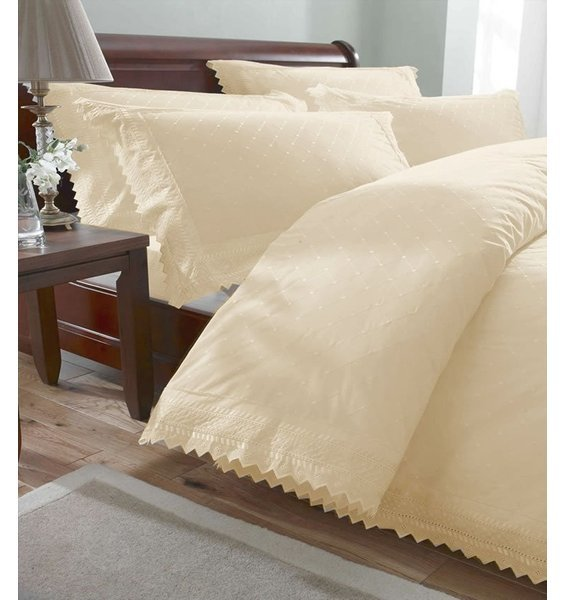 Classic cream broaderie anglaise bedding set with delicate pointed edging.