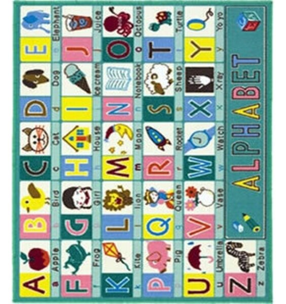 Large, green, rectangular rug patterened with the alphabet and images of the associated words.