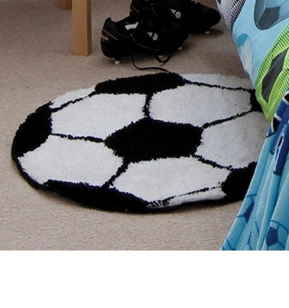 Black and white, round football rug.