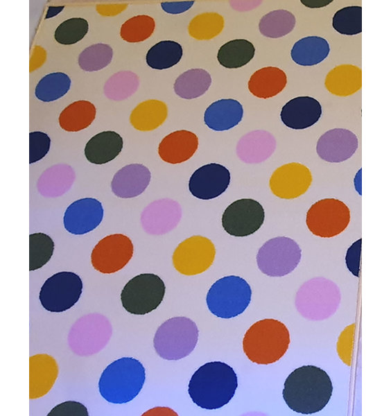 Large, rectangular off white rug patterned with large multicoloured spots - blue, pink, orange, yellow, lilac, green and red