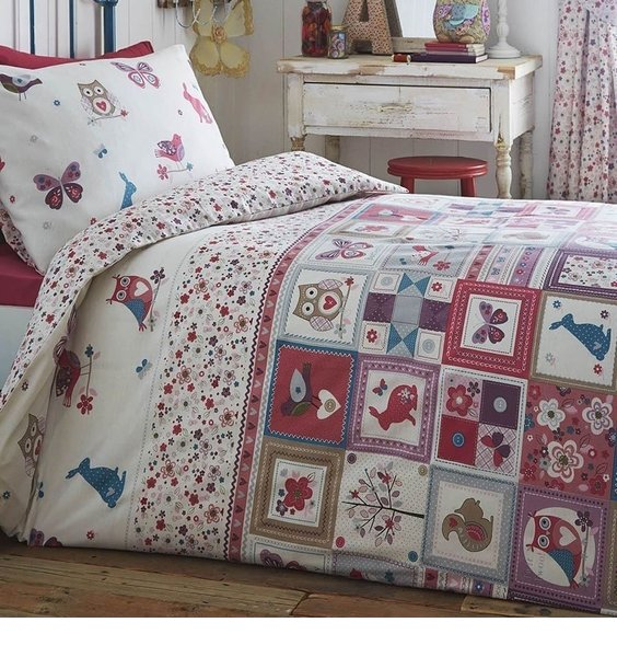 Patchwork Design with Woodland Animals and Flowers. The Reverse has a small floral pattern.