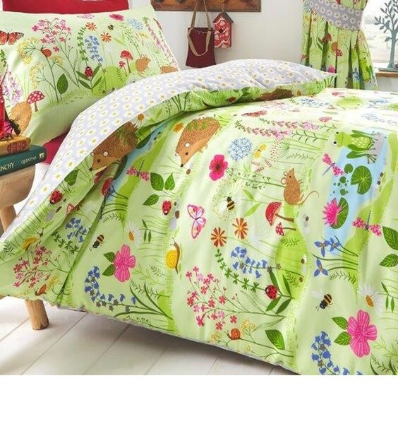 Bluebell Woods, Toddler Bed Set. Green Forest filled with Woodland Animals. Reverse has a grey and white daisy print.