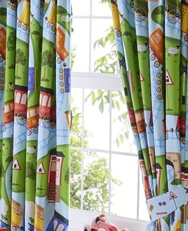 Vibrantly coloured, toy trains themed, curtains. Orange, red, yellow and blue trains, wagson, track and crossings.