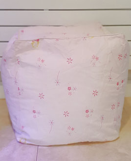 Child sized, pink bean cube with pink and purple flowers and butterflies and fairy princesses