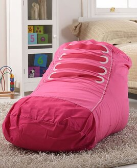 pink and white trainer shaped bean bag