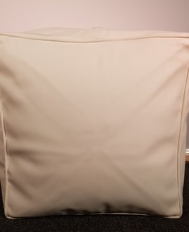 Beige bean cube or footstool in faux leather - 44 x 44 x 44 cm