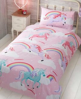 Kids pink, star patterned duvet cover with rainbows and pink, lilac and turquoise unicorns.