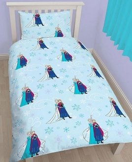 Disney Frozen Toddler Bedding. Elsa & Anna on a pale blue, snowflake patterned background.