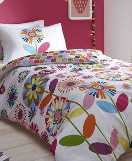 White bedding, filled with vibrant flowers, stems and leaves. The reverse is a colourful checker board pattern.