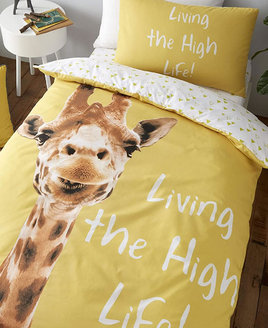 Cute smilling giraffe, living the high life on a natural yellow background.