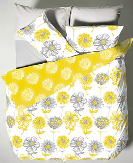 White duvet, with a yellow reverser patterned with large grey and yellow flowers.