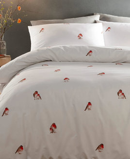 Crisp white backgroung patterend with cute Christmas Robins.
