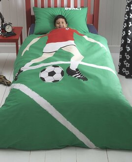 Green background with footballer bedding with a black and white football patterned reverse.