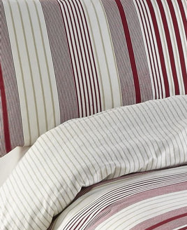 Cosy flannelette red and white sized stripes, with a reverse of off-white with thin gold stripes.