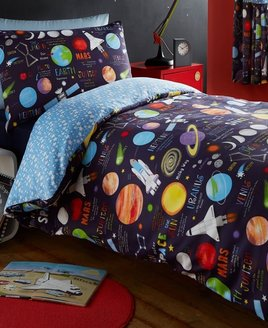 Multicoloured planets, stars & spaceships on a dark background. Duvet with white star patterned pale blue reverse.