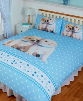 Adorable Labrador Puppies Duvets. 2 puppies on a pale blue and white patterned background