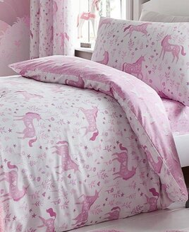 Reversible two tone pink toddler bed set with a floral pattern and heart adorned unicorns.